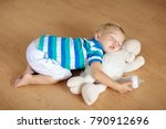 baby sleeping on wooden floor...   Shutterstock . vector #790912696