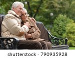 couple sitting on wooden bench   Shutterstock . vector #790935928