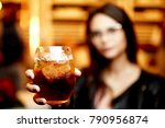 photo of cocktail in a hand of... | Shutterstock . vector #790956874