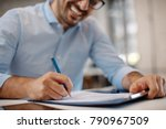 Young Businessman Signing A...