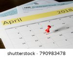 calendar on top of form 1040... | Shutterstock . vector #790983478