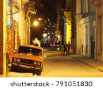 Small photo of Havana, Cuba - December 25, 2017: A Lada is parked at night on a small street in downtown Havana. Ladas were commonly imported from the Soviet Union through the 1970s and 1980s.