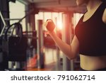 woman with dumbbell workout... | Shutterstock . vector #791062714