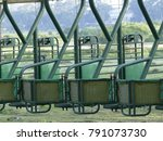 Small photo of A starting gate also called a starting barrier or starting stalls is a machine used to ensure a fair start to in horse racing and dog racing.
