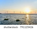wind turbine farm at sunset... | Shutterstock . vector #791125426