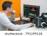 a young man designer using... | Shutterstock . vector #791199118