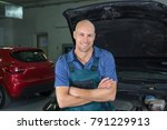 young car service technician. | Shutterstock . vector #791229913