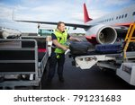 worker arranging luggage on... | Shutterstock . vector #791231683