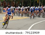 ARLINGTON, VIRGINIA - JUNE 12: A cyclist leads in the U.S. Air Force Cycling Classic on June 12, 2011 in Arlington, Virginia - stock photo