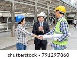 engineers are shaking hands... | Shutterstock . vector #791297860