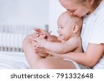 young mother and her happy... | Shutterstock . vector #791332648