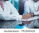saudi businessmen hands signing ... | Shutterstock . vector #791345410