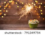 cupcake with sparkler on old...   Shutterstock . vector #791349754
