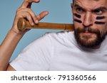 man with a bat on a blue... | Shutterstock . vector #791360566