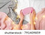 female hands hold a sleep mask. ...