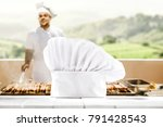 cook chef hat on desk and man... | Shutterstock . vector #791428543