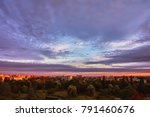 Small photo of Sky with clouds at sunrise over morning city.