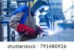 Small photo of Welding with sparks by Process fluxed cored arc welding , Welding by Welder Thailand