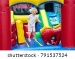 child jumping on colorful... | Shutterstock . vector #791537524