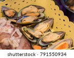 fresh mussels and squid in... | Shutterstock . vector #791550934