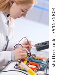 young woman fix pc component in ... | Shutterstock . vector #791575804