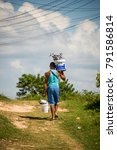 Small photo of Cienfuegos, Cuba - November 2016: Fisherman bringing fresh fish back home.