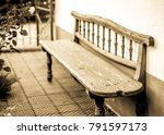 old bench in front of a wall | Shutterstock . vector #791597173