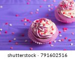 Two Cupcakes With Creamy Pink...