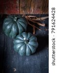 Small photo of two whole acorn squash in rustic setting