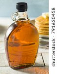 raw organic amber maple syrup... | Shutterstock . vector #791630458
