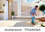 man renovating rooftop patio...   Shutterstock . vector #791646364
