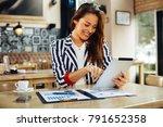 young businesswoman working... | Shutterstock . vector #791652358