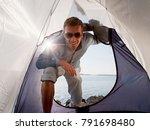man entering tent by sea | Shutterstock . vector #791698480