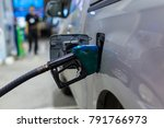 grey car at gas station being... | Shutterstock . vector #791766973