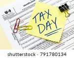 a w9 tax form with tax day... | Shutterstock . vector #791780134