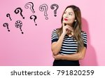 question marks with young woman ... | Shutterstock . vector #791820259