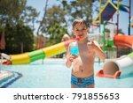 a cute toddler boy drinking a...   Shutterstock . vector #791855653