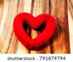 red heart on wooden floor   Shutterstock . vector #791879794
