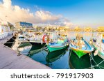 fishing boats docked at the... | Shutterstock . vector #791917903