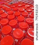 Small photo of background of red screw top pet plastic jar with airtight feature, best used during chinese lunar new year to store cookies snacks and goodies, or to keep kitchen ingredients dry and clean
