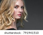 curly blonde hair woman portrait | Shutterstock . vector #791941510