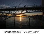 sea with bridge at sunset | Shutterstock . vector #791948344