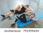 sporty young couple doing abs... | Shutterstock . vector #791959654