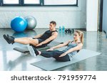 couple doing abs exercises on... | Shutterstock . vector #791959774
