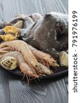 whole octopus and shrimps with... | Shutterstock . vector #791976199
