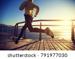 sporty female jogger morning... | Shutterstock . vector #791977030