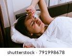 sad sleepy girl lies in bed ... | Shutterstock . vector #791998678