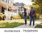 couple walking along suburban... | Shutterstock . vector #792009394