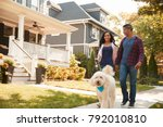 couple walking dog along... | Shutterstock . vector #792010810