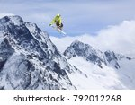 skier jump in the mountains.... | Shutterstock . vector #792012268